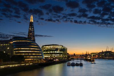 Dusk settles over London after sunset along the River Thames, with the Shard, London, England