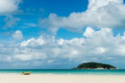 A small dinghy sits on the white sand of Whitehaven Beach, Whitsunday Island, Australia, Pacific