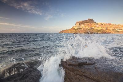 Waves of blue sea frame the village perched on promontory, Castelsardo, Gulf of Asinara, Italy