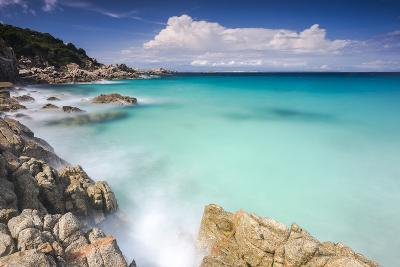 White rocks and cliffs frame the waves of turquoise sea, Santa Teresa di Gallura, Sardinia, Italy