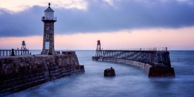 Whitby Pier at sunset, Yorkshire, England, United Kingdom, Europe