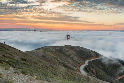 Golden Gate Bridge with morning fog shot at sunrise from Slackers Hill. San Francisco, Marin County