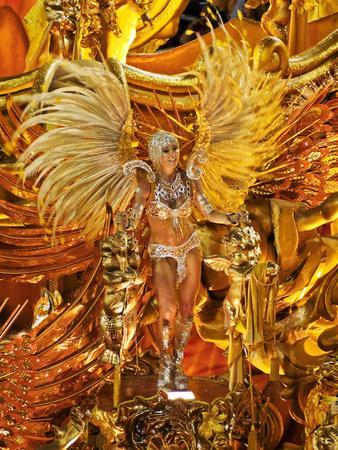 Brazil, State of Rio de Janeiro, City of Rio de Janeiro, Samba Dancer in the Carnival Parade at The