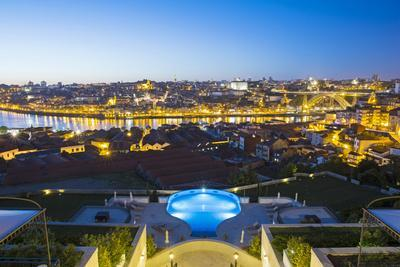 Portugal, Douro Litoral, Porto. Dusk view towards the old town of Porto and the Ribeira district fr