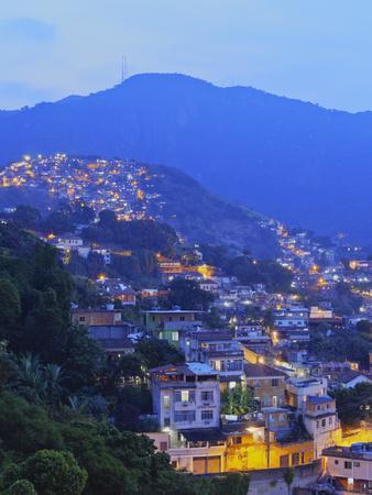 Twilight view of the favelas Unidos de Santa Teresa Morro do Escondidinho and Morro dos Prazeres, R