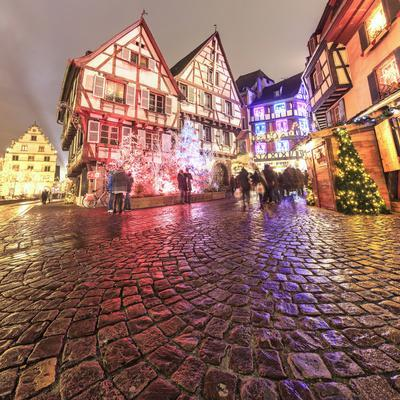 Panorama of typical houses enriched by Christmas ornaments and lights at dusk, Colmar, Haut-Rhin de