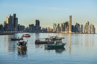 Little fishing boats and the skyline of Panama City, Panama, Central America