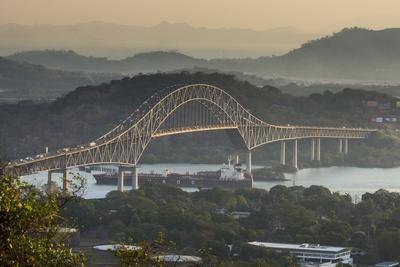 Cargo boat passes the Bridge of the Americas on the Panama Canal, Panama City, Panama, Central Amer
