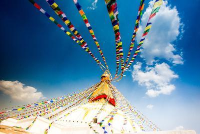 Prayer flags and Buddhist stupa at Bouddha (Boudhanath), UNESCO World Heritage Site, Kathmandu, Nep