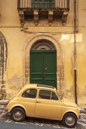 Old Fiat 500 parked in street, Noto, Sicily, Italy, Europe