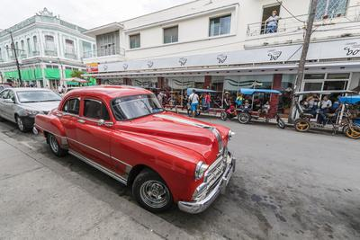 Classic 1950s Pontiac taxi, locally known as almendrones in the town of Cienfuegos, Cuba, West Indi
