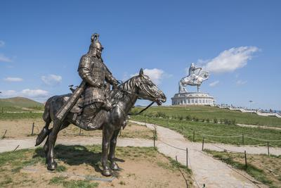 Statue of a Mongolian Empire warrior and Genghis Khan Statue Complex in the background, Erdene, Tov