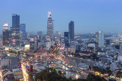 City skyline at night showing the Bitexco tower, Ho Chi Minh City (Saigon), Vietnam, Indochina, Sou