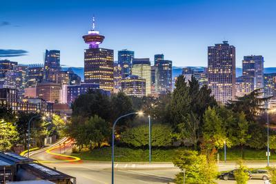 View of city skyline and Vancouver Lookout Tower at dusk from Portside, Vancouver, British Columbia