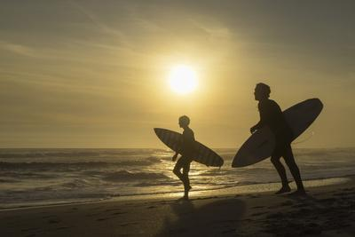Surfers on Bloubergstrand at sunset, Cape Town, Western Cape, South Africa, Africa