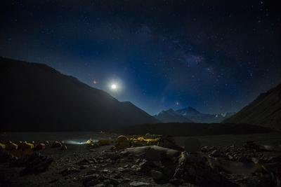 The expanse of northside Mount Everest Base camp glows with the light of the rising moon.