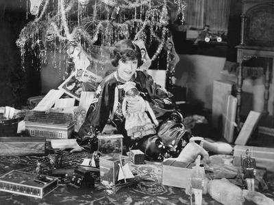 Portrait of Teenage Girl with Opened Christmas Presents