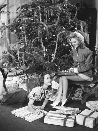 Teenage Girls with Presents and Christmas Tree