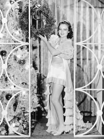 Woman in Lingerie Holding a Christmas Wreath