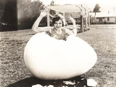 Woman Popping Out of Giant Egg