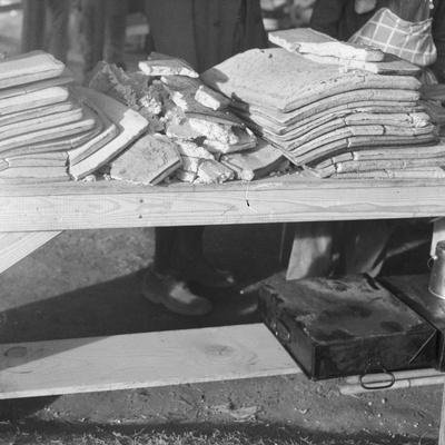 Cornbread for flood refugees at the Forrest City camp, Arkansas, 1937