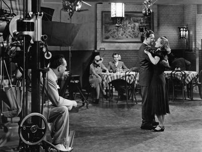 MANNEQU 1938 directed by FRANK BORZAGE Frank borzage (left) directs Spencer Tracy and Joan Crawford
