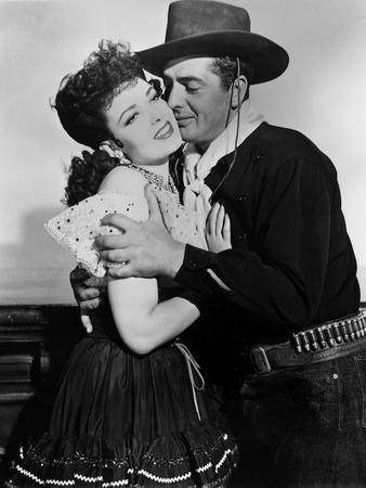 MY DARLING CLEMENTINE, 1946 directed by JOHN FORD Linda Darnell and Victor Mature (b/w photo)
