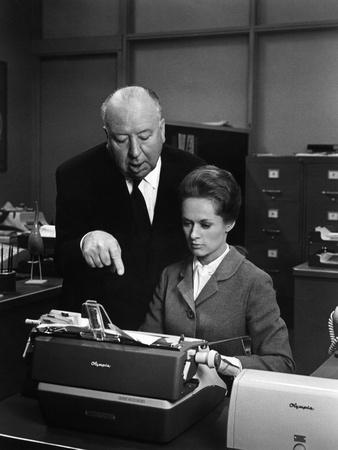 MARNIE, 1964 directed by ALFRED HITCHCOCK On the set, Alfred Hitchcock and Tippi Hedren (b/w photo)