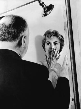 PSYCHO, 1960 directed by ALFRED HITCHCOCK On the set, Alfred Hitchcock directs Janet Leigh (b/w pho