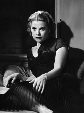 REAR WINDOW, 1954 directed by ALFRED HITCHCOCK Grace Kelly (b/w photo)