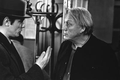 "Alain Delon and director Joseph Losey on set of film ""Monsieur Klein"", 1976 (b/w photo)"
