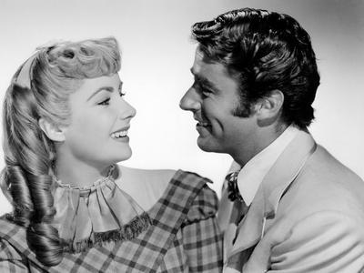 LITTLE WOMEN, 1949 directed by MERVYN LeROY Elizabeth Taylor and Peter Lawford (b/w photo)