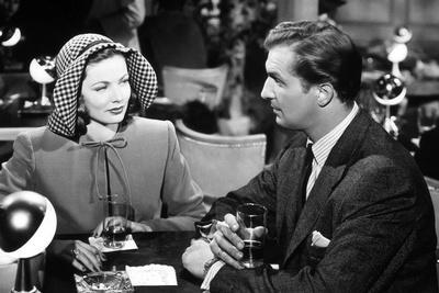 LAURA, 1944 directed by OTTO PREMINGER Gene Tierney and Vincent Price (b/w photo)