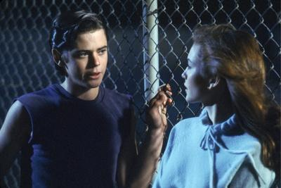 THE OUTSIDERS, 1982 directed by FRANCIS FORD COPPOLA Thomas C. Howell and Diane Lane (photo)