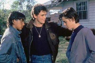 THE OUTSIDERS, 1982 directed by FRANCIS FORD COPPOLA Ralph Macchio, Matt Dillon andThomas C. Howell