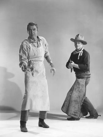 THE MAN WHO SHOT LIBERTY VALANCE, 1962 directed by JOHN FORD James Stewart and John Wayne (b/w phot