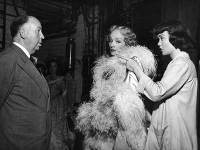 STAGE FRIGHT, 1950 directed by ALFRED HITCHCOCK On the set, Alfred Hitchcock, Marlene Dietrich and