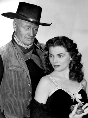 RED RIVER, 1948 directed by HOWARD HAWKS John Wayne and Joanne Dru (b/w photo)