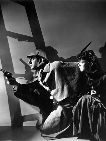THE ADVENTURES OF SHERLOCK HOLMES, 1939 directed by ALFRED WERKER Basil Rathbone and Ida Lupino (b/