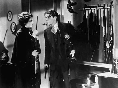 SCARFACE, 1932 directed by HOWAR HAWKS AND RICHARD ROSSON Ann Dvorak and Paul Muni (b/w photo)