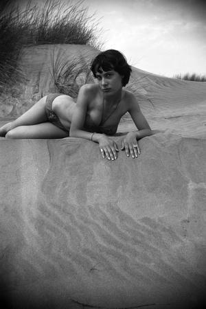 Bernadette Lafont, as a young woman, on the beach, south of France, c. 1955 (b/w photo)