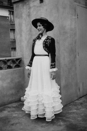 Bernadette Lafont, as a young woman, with traditional suit from Nimes, c. 1954 (b/w photo)