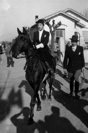 Bernadette Lafont as a young woman (16) on horse in Nimes, France, 1954 (b/w photo)