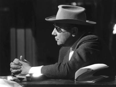 Le realisateur Jean-Pierre Melville sur le tournage du film Un Flic, 1972 (b/w photo)