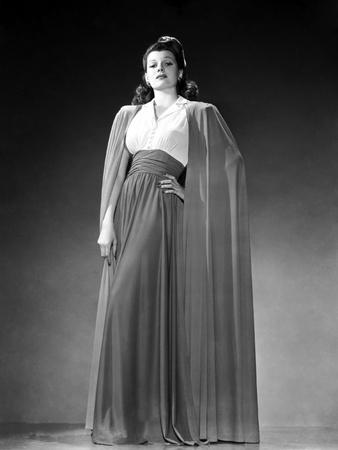 , 1941: American film actress Rita Hayworth (1918 - 1987) wearing a long skirt with a matching cloa