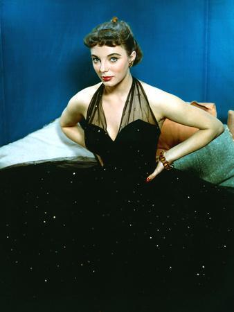 British actress Joan Collins Wwearing halter top dress with rhinestones (photo)