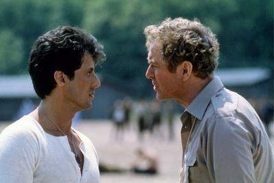 ESCAPE TO VICTORY, 1981 directed by JOHN HUSTON Sylvester Stallone and Michael Caine (photo)