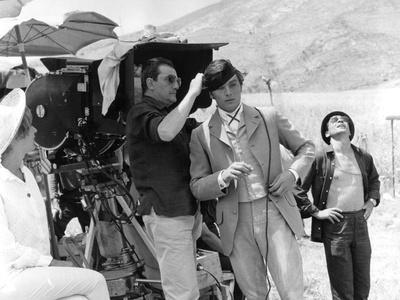 "Alain Delon and director Luchino Visconti on set of film ""The Leopard"", 1962 (b/w photo)"