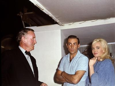 British author Ian Fleming, actors Sean Connery and actress Shirley Eaton on the set of the film Go
