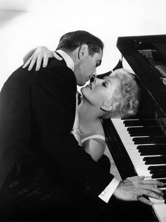 THE EDDY DUCHIN STORY, 1956 directed by GEORGE SIDNEY Tyrone Power and Kim Novak (b/w photo)